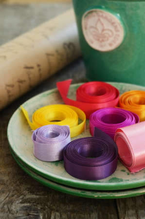 floristics: Set of colorful ribbons and wrapping paper for floristics and decor Stock Photo
