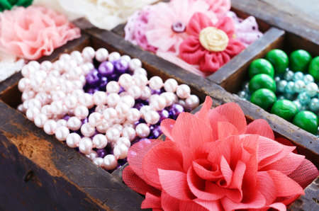 Set of various stylish accessories in wooden organizer, selective focus photo