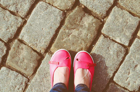walking shoes: Pink shoes and woman legs in jeans