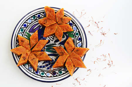 sweet: Homemade carrot halwa, traditional indian sweet, on blue  plate