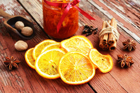 dried orange: Decoration with dried orange peels, orange confiture and spices - cinnamon, nutmeg, cloves and anise stars Stock Photo