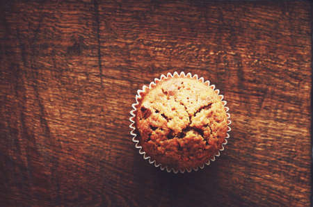 muffin: Homemade carrot muffin with empty space on brown wooden background Stock Photo