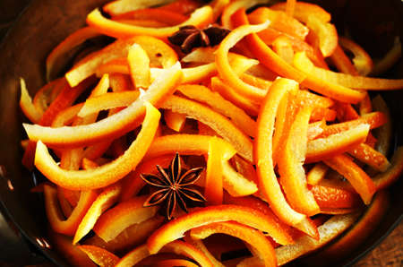 sugared: Cooking homemade sugared orange slices with spices, close up