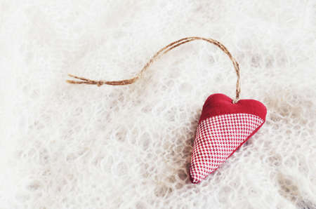 downy: Red decorative heart on traditional Russian downy shawl for Christmas and Valentines Day