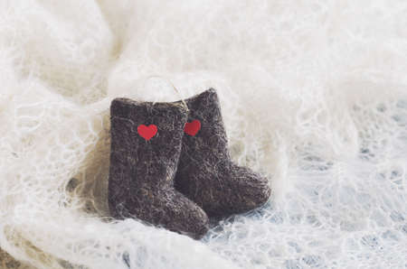 downy: Valenki - traditional Russian winter footwear on knitted downy shawl, with little hearts