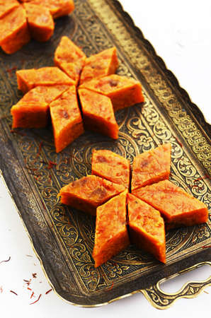 indian sweet: Homemade carrot halwa, traditional indian sweet, on brass tray