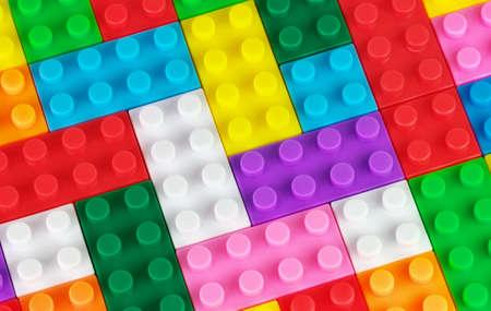 plastic bricks: Toy background made of toy colored plastic bricks