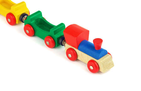 Wooden colorful toy train isolated on white background photo