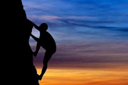 mountain climbing: Rock climber at sunset background. Sport and active life