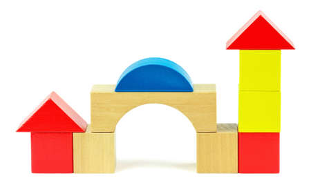 tidiness: House made from toy wooden colorful building blocks on a white background Stock Photo