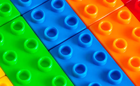 plastic bricks: Toy background made of colored plastic bricks Stock Photo