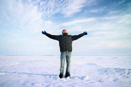 raised: Persons on ice. Man with arms raised