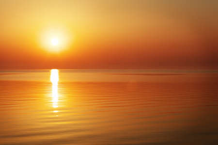 red sunset: Beautiful sunset over the ocean. Sunrise in the sea Stock Photo