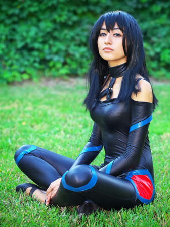 Young girl sitting on the grass. Original cosplay character