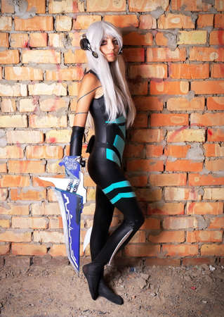 original idea: Young girl holding a blade in the dungeon Original cosplay character. Artistic shoot, new conceptual idea Stock Photo