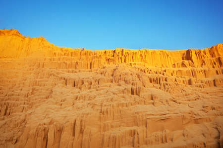 sand pit: Beautiful sand pit with lines on the golden sand and blue sky.
