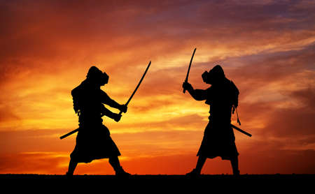 warrior: Silhouette of two samurais in duel. Picture with two samurais and sunset sky