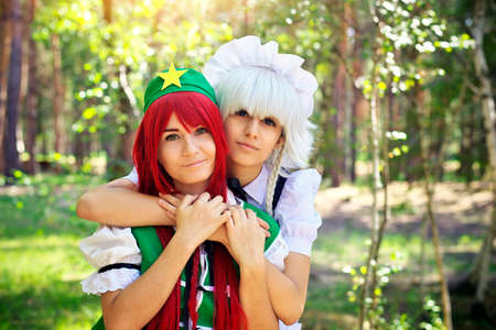 manga girl: Two beautiful girls in the park. Cosplay characters Stock Photo