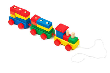 bar magnet: Wooden colorful toy train with rope isolated on white background