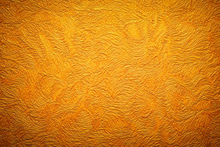 textured paper: Gold background texture. Wallpaper on the wall.