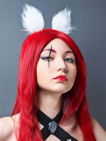 formidable: Beauty Fashion Model Girl with red wig on gray background. Stock Photo