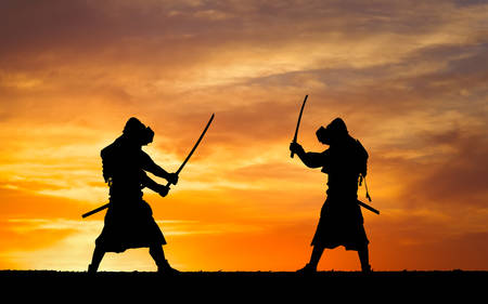Silhouette of samurais in duel. Picture with two samurais and sunset sky