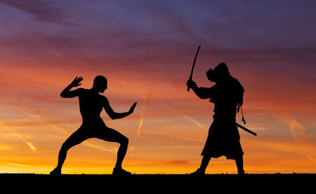 mercenary: Silhouette of two samurais in duel. Picture with two samurais and sunset sky