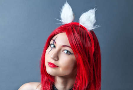 Beauty Fashion Model Girl with red wig on gray background