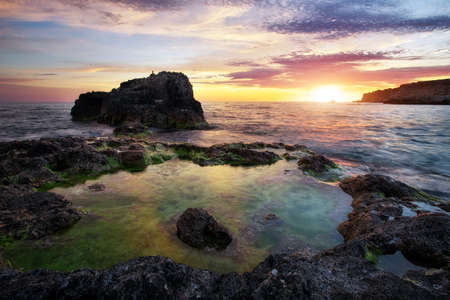 Beautiful summer landscape with sunset, colorful sky and sea. Composition of nature