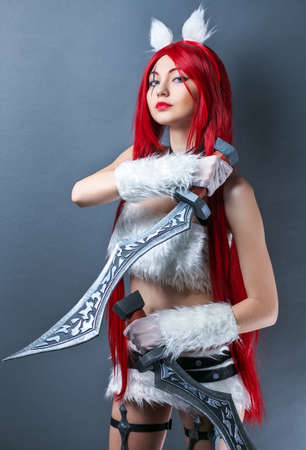Beauty Fashion Model Girl with red wig and swords on gray background. Cosplay Character from game