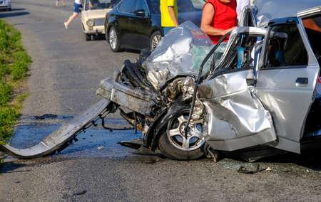Damaged vehicle closeup after car crash. A terrible accident.