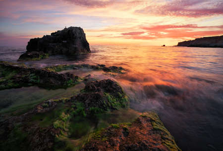 Beautiful summer landscape with sunset, colorful sky and sea coast. Composition of nature