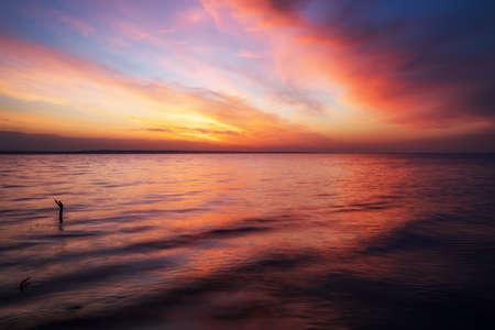 Magic orange and red sunset over sea. Sunrise over Beach