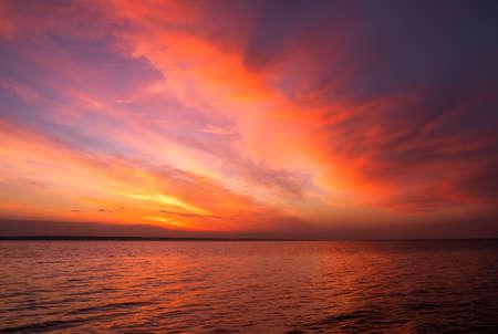 Magic orange sunset over sea. Sunrise over Beach Stock Photo