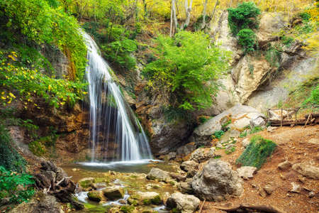 Djur-djur waterfall is located on the Ulu-Uzen river in the Crimea. Spring rill flow. Nature composition.