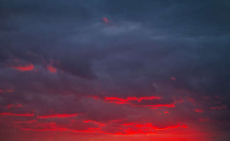 Beautiful bright colorful sky. Picture taken at sunset. Red-orange background with nice paints. Rare sunrise. Natural composition