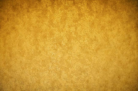 Gold background texture. Wallpaper on the wall. Element of design.