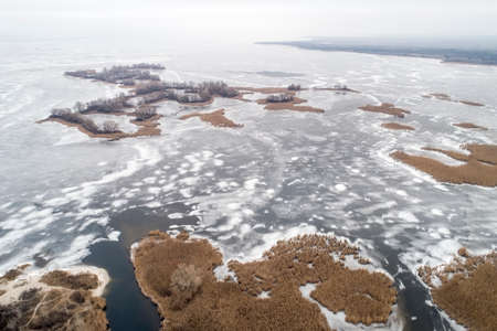 Frozen ice on the shore of the sea as a background, a birds-eye view. Early winter