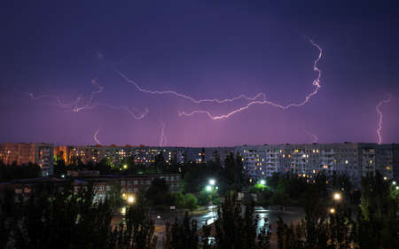 Lightning strikes down over the city at night. Beautiful shot. Long Exposure Photography
