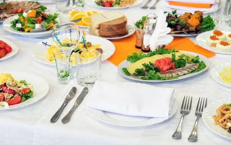 Different meals for the guests on Banquet table. Delicious dishes on the table in the restaurant. Serving table for birthday or wedding