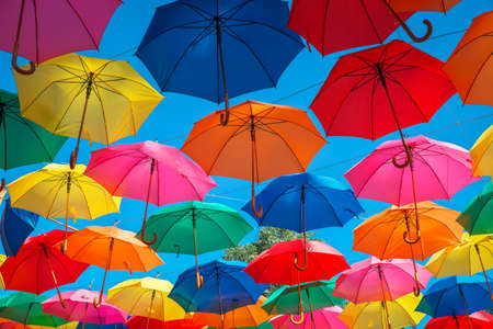 Colorful umbrellas in the sky as background. Street decoration.