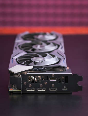 Modern game graphic video card. Computer gaming powerful modern graphic card on the table