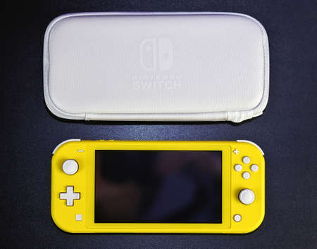 MOSCOW, RUSSIA - October 08, 2019: Nintendo Switch Lite is Nintendo's latest entry into handheld gaming. Priced at $199.99, the Switch Lite is available in yellow color 報道画像