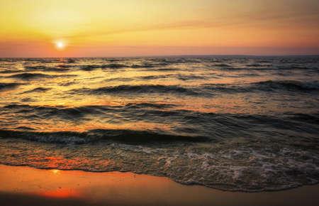 Colorful ocean beach sunrise. Dawn over the sea. Nature composition