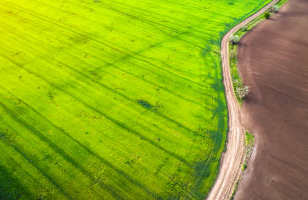 Aerial view of agricultural fields and road. Rainy weather. Natural grass. Imagens - 148480671