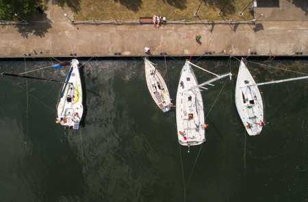 Pier with boats, marina lot. Aerial top view from drone.