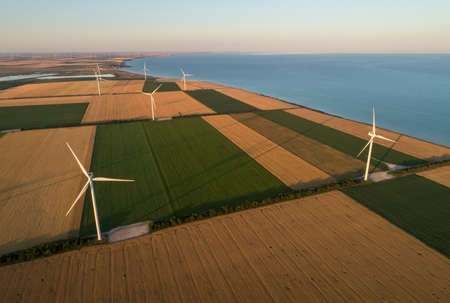 Beautiful landscape with windmills on the field. Birds eye view