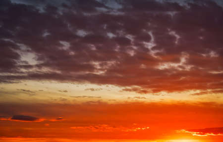 Beautiful Twilight sky background. Colorful Fiery orange and red sunset sky.