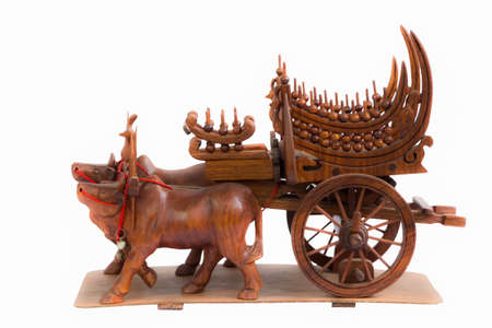 Isolation Cow and Carts wood art in thailand photo