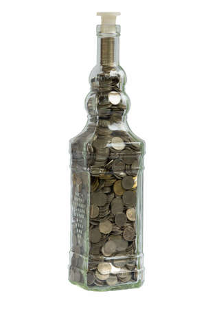 aving money concept with coins put in the glass  photo